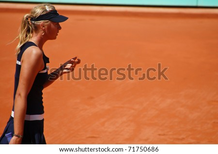 PARIS, FRANCE - MAY 28: Maria Sharapova from Russia competes her first round match at Roland Garros on May 28, 2008 in Paris, France. - stock photo