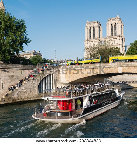 PARIS, FRANCE - MAY 16, 2014: Notre Dame Cathedral and Seine river. The most famous Gothic Cathedral (1163 - 1345) on the eastern half of the Cite Island. - stock photo