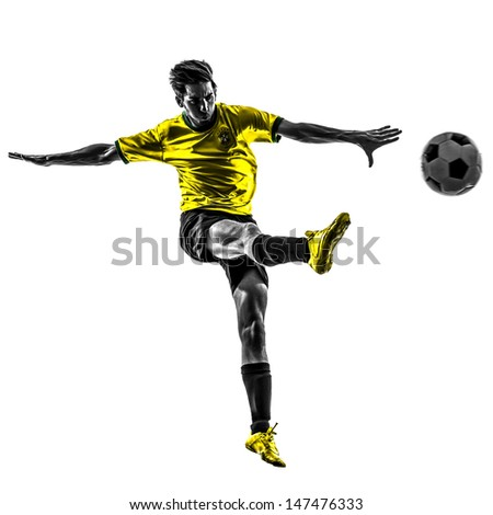 Paris, France - May 3,2013: one brazilian soccer football player young man kicking in silhouette at Paris, France on May 3th 2013 - stock photo