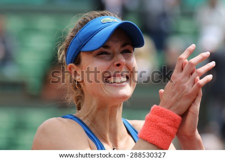 PARIS, FRANCE- MAY 29, 2015: Professional tennis player Alize Cornet of France celebrates victory after third round match at Roland Garros 2015 in Paris, France - stock photo