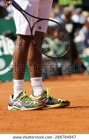 PARIS, FRANCE- MAY 27, 2015: Professional tennis player Gael Monfis wears custom Asics tennis shoes during second round match at Roland Garros 2015 in Paris, France - stock photo