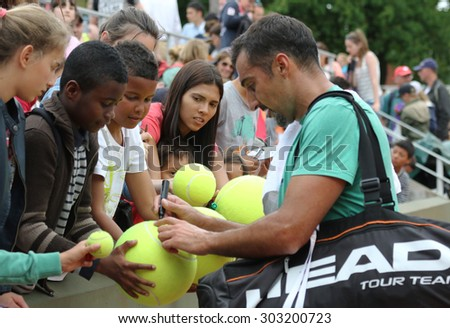 PARIS, FRANCE- MAY 23, 2015: Professional tennis player Nenad Zimonjic of Serbia signing autographs after practice for Roland Garros 2015 in Paris, France - stock photo