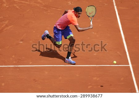 PARIS, FRANCE- MAY 30, 2015: Professional tennis player Nick Kyrgios of Australia in action during his third round match at Roland Garros 2015 in Paris, France - stock photo