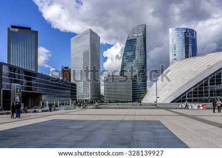 PARIS, FRANCE - MAY 13, 2014: Skyscrapers in business district of Defense to the west of Paris. Defense is biggest business district in France and most of large companies have offices here. - stock photo