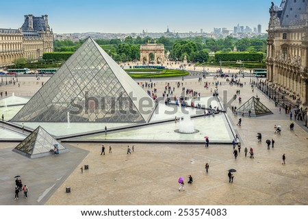 Paris, France - May 2, 2011: Square of Louvre. The Louvre museum and the pyramid on 2nd of May 2011 in Paris, France. The Louvre was once a palace and is now a museum.  - stock photo