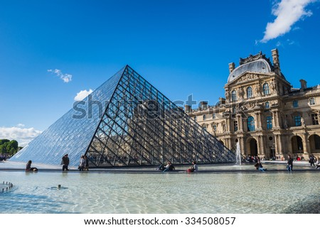Paris, France - May 3, 2015: The crystal pyramid of Louvre museum, Paris - stock photo