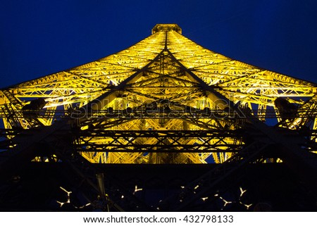PARIS, FRANCE - MAY 14, 2013: This is view of the top of the Eiffel tower in the night illumination of its backlight. - stock photo