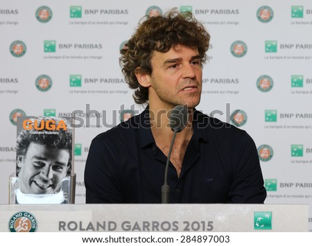 PARIS, FRANCE- MAY 30, 2015: Three times Grand Slam champion Gustavo Kuerten during press conference at Roland Garros 2015 in Paris, France - stock photo