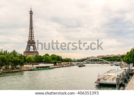 PARIS, FRANCE - MAY 14, 2014: Tour Eiffel (Eiffel Tower), river Seine at sunset. Eiffel Tower, named after engineer Gustave Eiffel, is tallest structure in Paris and most visited monument in world. - stock photo