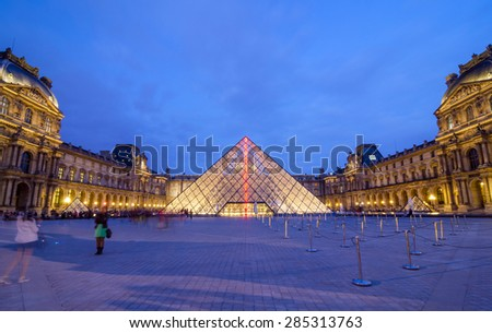 Paris, France - May 14, 2015: Tourist visit Louvre museum at dusk on May 14, 2015 in Paris. Louvre is one of the biggest Museum in the world, receiving more than 8 million visitors each year.  - stock photo