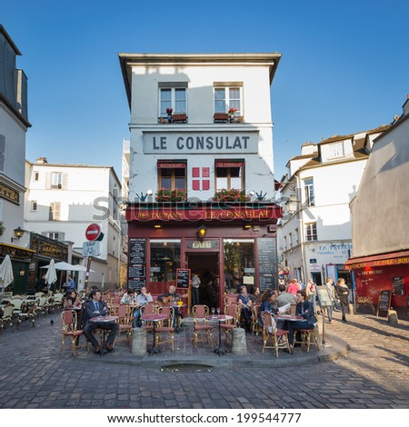 PARIS, FRANCE - MAY 15, 2014: Tourists walking in front of Le Consulat, a typical cafe in Montmartre area. - stock photo