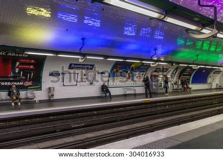 PARIS, FRANCE - May 29: Travellers and commuters waiting at subway station Rambuteau on May 29, 2015, Paris, France - stock photo