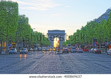 PARIS, FRANCE - MAY 3, 2012: Triumphal Arch of the Star in Paris in France, at sunset. The Arc de Triomphe de Etoile is one of the most known monuments in Paris - stock photo
