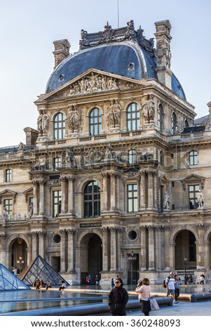 PARIS, FRANCE - MAY 18, 2014: View of Louvre building at courtyard of Louvre Museum at sunset. Louvre Museum is one of the largest and most visited museums worldwide. - stock photo