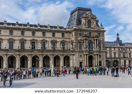 PARIS, FRANCE - MAY 8, 2014: View of Louvre Museum courtyard. Louvre Museum is one of the largest and most visited museums worldwide. - stock photo