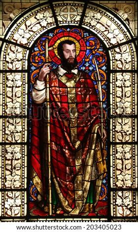 PARIS, FRANCE - NOV 10, 2012: Saint Dionysius, stained glass, Saint-Vincent-de-Paul Church (design Jean-Baptiste Lepere, was built during 1824 - 1844) dedicated to Saint Vincent de Paul - stock photo