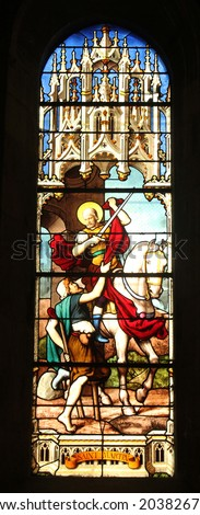 PARIS, FRANCE - NOV 11, 2012: Saint Martin, stained glass.The Church of St Severin is Catholic church in the Latin Quarter. It is one of the oldest churches on the Left Bank. - stock photo