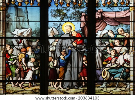 PARIS, FRANCE - NOV 11, 2012: Saint Vincent de Paul gathering with the Daughters of Charity abandoned children. The Church of St Severin is Catholic church in the Latin Quarter.  - stock photo