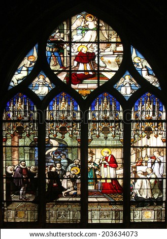 PARIS, FRANCE - NOV 11, 2012: St. Aloysius Gonzaga receiving first communion from the hands of Saint Charles Borromeo, stained glass. The Church of St Severin is Catholic church in the Latin Quarter.  - stock photo