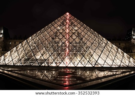 Paris, France - Nov 1, 2015. View of pyramid Louvre museum and Louvre palace[Palais du Louvre] in winter season at night. Louvre Museum is one of the largest and most visited museums worldwide. - stock photo