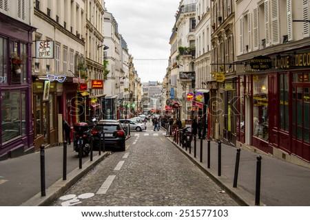 PARIS, FRANCE - November 11, 2014: A view down the street Rue des Martyrs in Montmartre district, Paris, France. - stock photo