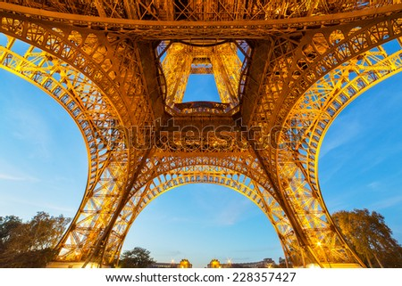 PARIS, FRANCE - NOVEMBER 1: Abstract view of illuminated Eiffel Tower in the evening on November 1, 2014. Eiffel Tower is the most popular tourist attraction in France.  - stock photo