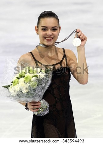 PARIS, FRANCE - NOVEMBER 16, 2013: Adelina SOTNIKOVA of Russia poses during the victory ceremony at Trophee Bompard ISU Grand Prix at Palais Omnisports de Bercy. - stock photo
