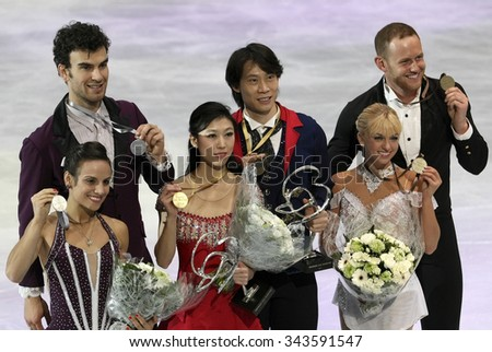 PARIS, FRANCE - NOVEMBER 16, 2013: DUHAMEL/RADFORD (L), PANG/TONG, DENNEY/John COUGHLIN pose during the victory ceremony at Trophee Bompard ISU Grand Prix at Palais Omnisports de Bercy. - stock photo