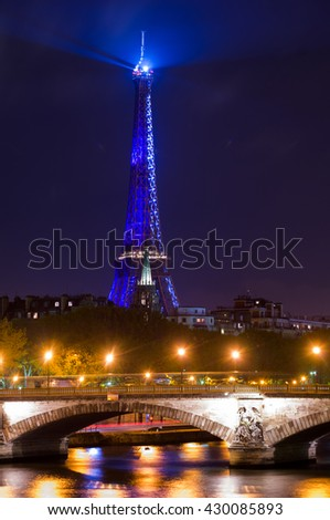 PARIS,FRANCE-NOVEMBER 16:Eiffel Tower glowing blue illuminated at night on the 16 november 2009, in Paris,France - stock photo