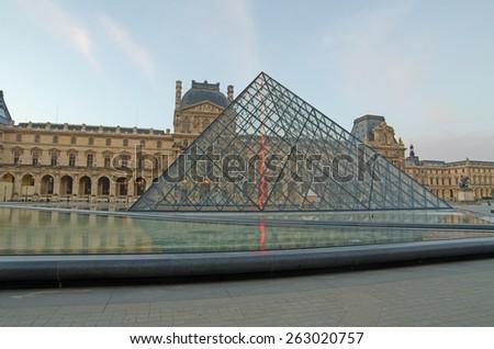 PARIS, FRANCE â?? 29 NOVEMBER, 2014: Louvre in the sunrise. The pyramid - stock photo