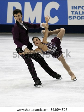 PARIS, FRANCE - NOVEMBER 16, 2013: Meagan DUHAMEL / Eric RADFORD of Canada perform free program at Trophee Bompard ISU Grand Prix at Palais Omnisports de Bercy. - stock photo