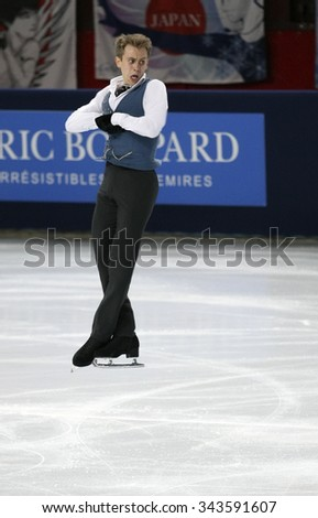 PARIS, FRANCE - NOVEMBER 16, 2013: Michal BREZINA of Czech Republic performs free program at Trophee Bompard ISU Grand Prix at Palais Omnisports de Bercy. - stock photo