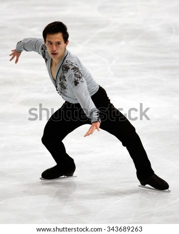 PARIS, FRANCE - NOVEMBER 16, 2013: Patrick CHAN of Canada performs free program at Trophee Bompard ISU Grand Prix at Palais Omnisports de Bercy. - stock photo