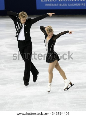 PARIS, FRANCE - NOVEMBER 16, 2013: Penny COOMES / Nicholas BUCKLAND of Great Britain perform free dance at Trophee Bompard ISU Grand Prix at Palais Omnisports de Bercy. - stock photo