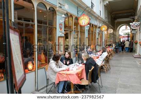 Paris, France - 1 November 2002: People eating and drinking in a street restaurant of Paris on France - stock photo