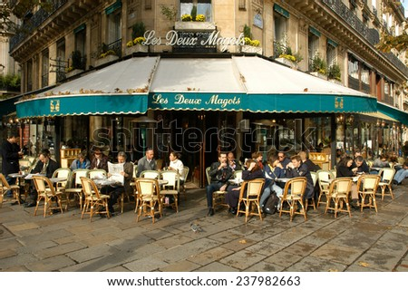 Paris, France - 4 November 2002: People eating and drinking in a street restaurant of Paris on France - stock photo