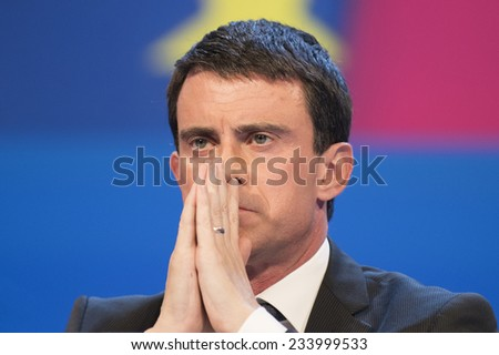 PARIS, FRANCE - NOVEMBER 27, 2014 : Prime Minister Manuel Valls during the 97th congress of France mayors in exhibition center of porte de versailles - stock photo