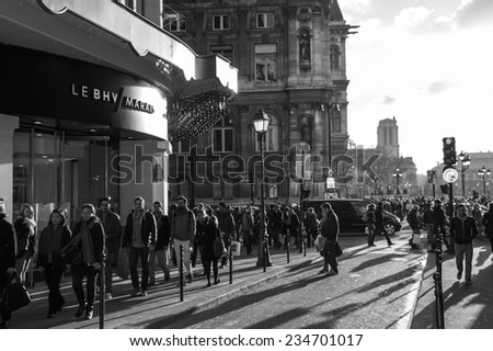 PARIS, FRANCE - NOVEMBER 30, 2013: Shopping crowd near BHV department store located across Hotel de Ville (City Hall). Christmas shopping in Paris starts already in November. - stock photo
