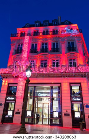 Paris, France-November 23, 2015 : The Christmas decoration on jewellery boutique Cartier located Champs Elysees avenue in Paris, France. - stock photo