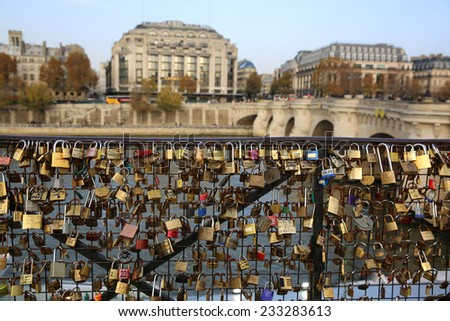 PARIS, FRANCE - NOVEMBER 23, 2014: The Pont des Arts in the Center of Paris. It is now full of Love Lockers.  - stock photo