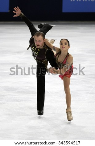 PARIS, FRANCE - NOVEMBER 16, 2013: Vera BAZAROVA / Yuri LARIONOV of Russia perform free program at Trophee Bompard ISU Grand Prix at Palais Omnisports de Bercy. - stock photo