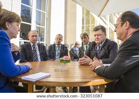 PARIS, FRANCE - Oct 02, 2015: German Chancellor Merkel, Russian President Vladimir Putin, President Ukraine Petro Poroshenko and French President Francois Hollande on the meeting in Normandy format - stock photo