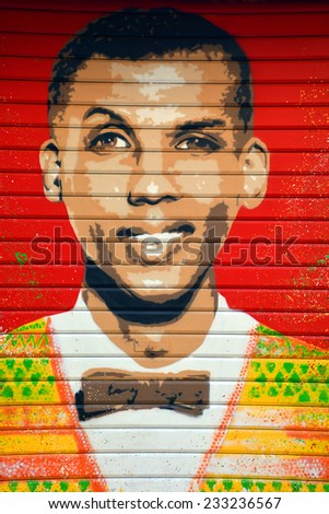PARIS FRANCE OCT 19: Street art belge singer Stromae  in Paris France oct 19 2014. Paris is the perfect place to walk in the back alleys and abandoned areas, looking for fresh air and street art.  - stock photo