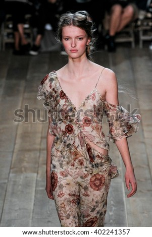 PARIS, FRANCE - OCTOBER 04: A model walks the runway during the Alexander McQueen show as part of the Paris Fashion Week Womenswear Spring/Summer 2016 on October 4, 2015 in Paris, France.  - stock photo