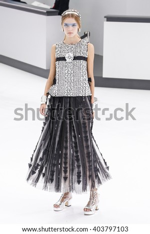 PARIS, FRANCE - OCTOBER 06: A model walks the runway during the Chanel show as part of the Paris Fashion Week Womenswear Spring/Summer 2016 on October 6, 2015 in Paris, France. - stock photo