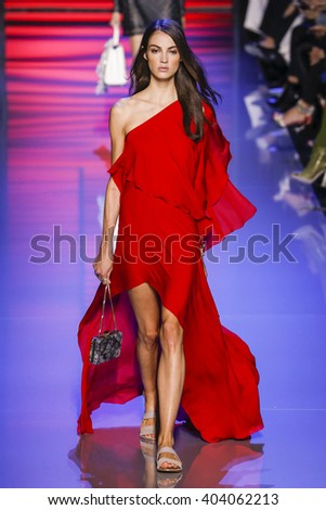 PARIS, FRANCE - OCTOBER 03: A model walks the runway during the Elie Saab show as part of the Paris Fashion Week Womenswear Spring/Summer 2016 on October 3, 2015 in Paris, France.  - stock photo