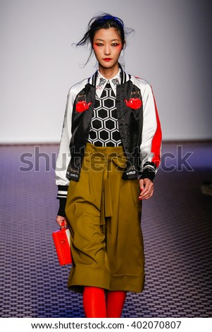 PARIS, FRANCE - OCTOBER 03: A model walks the runway during the Olympia Le -Tan show as part of the Paris Fashion Week Womenswear Spring/Summer 2016 on October 03, 2015 in Paris, France.  - stock photo