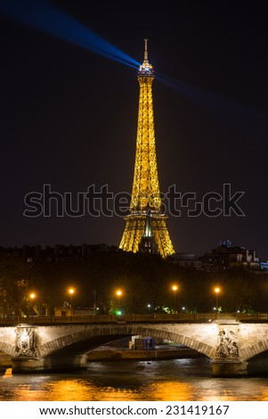 PARIS, FRANCE - OCTOBER 31: A view of illuminated Eiffel Tower in the night on October 31, 2014. Eiffel Tower is the most popular tourist attraction in France. - stock photo