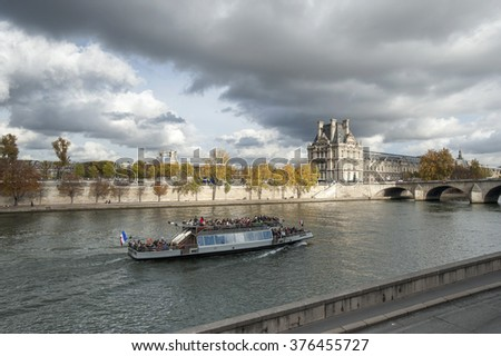 PARIS, FRANCE - October 2015: Modern transport boat on Senna in autumn. Paris - Only Editorial Use  - stock photo