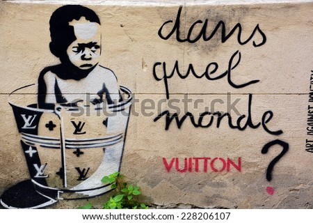 PARIS FRANCE OCTOBER 19: Street art poor child VS Vuitton Paris France october 19 2014. Paris is the perfect place to walk in the back alleys and abandoned areas, looking for fresh air and street art. - stock photo